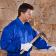 Stock Photo: Masonry mason stonecutter mwith hammer working