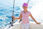 Child girl sailing in fishing boat holding rod — Stock Photo