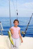 Child girl fishing in boat with mahi mahi dorado fish catch — Stock Photo