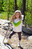 Explorer blond kid girl sith stick and winter white fur — Stock Photo