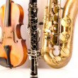 Sax tenor saxophone violin and clarinet in white — Stock Photo #19540999