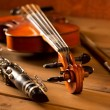 Classic music violin and clarinet in vintage wood - Stock Photo