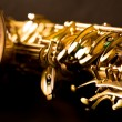 Tenor sax golden saxophone macro selective focus — Stock Photo #19542619