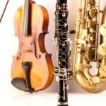 Sax tenor saxophone violin and clarinet in white — Stock Photo