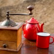Stock Photo: Retro old coffee grinder with vintage red teapot