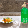 Stock Photo: Fruits tangerine and pear in vintage dish sodbottle