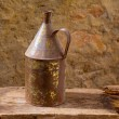 Stock Photo: Antique rusted iron jar with aged brass on vintage wood