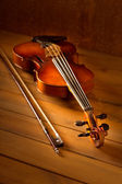 Classic music violin vintage in wooden background — Stock Photo