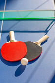 Table tennis ping pong two paddles and white ball — Stock Photo