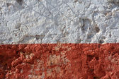 Aged whitewashed wall with red grunge paint — Stock Photo