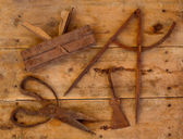 Aged tools wood planer wool scissors drawing compass — Stock Photo