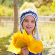 Stock Photo: Child girl in autumn poplar forest yellow fall leaves in hand