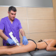 Mesotherapy gun therapy for cellulite doctor with woman — Stock Photo