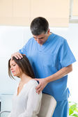 Physiotherapist doing myofascial therapy on woman patient — Stock Photo