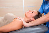 Myofascial therapy technique with therapist hands in woman — Stock Photo