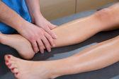 Lymphatic drainage massage therapist hands on woman leg — Stock Photo