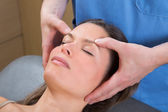 Facial massage relaxing theraphy on woman face — Stock Photo