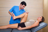 Hip mobilization therapy by physiotherapist to woman patient — Stock Photo