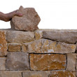 Mason hands working on masonry stone wall — Stock Photo #25351999