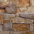 Stock Photo: Mason hands working on masonry stone wall