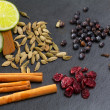 Cloves cardamom cinnamon juniper berries and cranberries - 