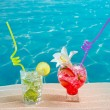 Mojito and strawberry cocktail on white sand beach - Stock Photo