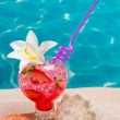Strawberry cocktail on beach sand with seashells — Stock Photo