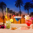 tropical cocktails on white sand mojito on sunset palm trees — Stock Photo