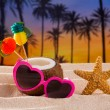 Coconut cocktail on tropical sand beach heart sunglasses — Stock Photo #25353449