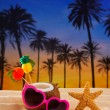 Coconut cocktail on tropical  sand beach heart sunglasses - Stock Photo