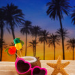Coconut cocktail on tropical sand beach heart sunglasses — Stock Photo #25353517