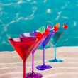 Colorful cocktail in a row with cherry on tropical sand beach — Stock Photo #25353661