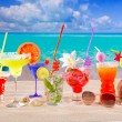 Colorful tropical cocktails at beach on white sand — Stock Photo