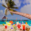 Colorful tropical cocktails at beach on white sand — Stock Photo #25354401