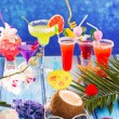 Colorful mixed cocktails in tropical blue wood — Stockfoto