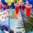 Colorful mixed cocktails in tropical blue wood — Stock Photo #25355533