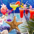 Colorful mixed cocktails in tropical blue wood — Stock Photo #25355551