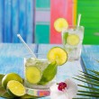 Cuban Mojito cocktail in tropical blue wood flowers and starfish — Stock Photo