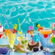 Colorful many tropical Cocktails in tropical blue wood — Stock Photo