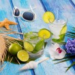 Cuban Mojito cocktail in tropical blue wood flowers and starfish — Stock Photo #25357199