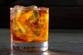 Whiskey whisky on the rocks on glass — Stock Photo