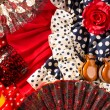 Stock Photo: Espantypical from Spain with castanets rose flamenco fan