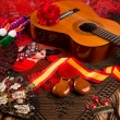 Stock Photo: Cassic spanish guitar with flamenco elements