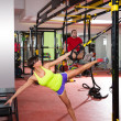 fitness trx training exercises at gym woman and man — Stock Photo