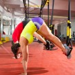 Fitness TRX training exercises at gym womand man — Stock Photo #25461409