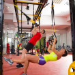 Fitness TRX training exercises at gym woman and man — Stock Photo #25462177