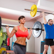 Stock Photo: Crossfit fitness gym weight lifting bar group