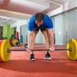 Crossfit fitness gym heavy weight lifting bar man workout - Stock Photo
