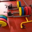 Crossfit fitness gym weight lifting bar equipment - Stock Photo