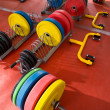 Stock Photo: Crossfit fitness gym weight lifting bar equipment